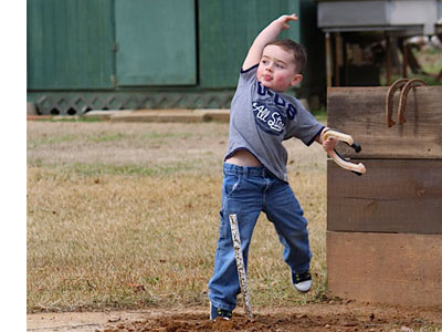 grandson of Ron & Polly pitching horseshoes